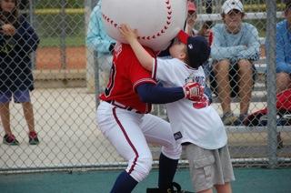 Baseball Fantasy camper giving mascot Homer a kiss