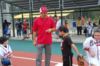 bruce hagen talking baseball with a camper